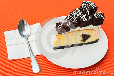 A piece of brownie cheesecake