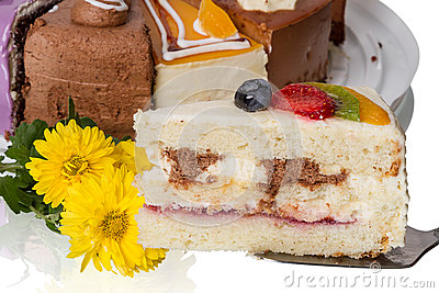 Piece of cake with fruit and  flowers