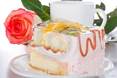 Piece of cake with fruits rose and cup