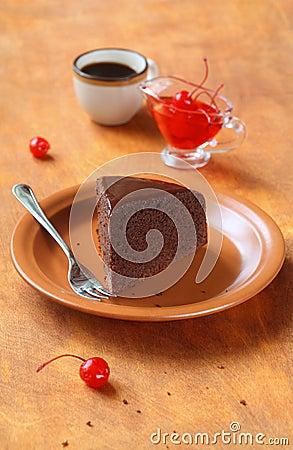 Piece of Chocolate Cake glazed with chocolate mirror glaze Stock Photo