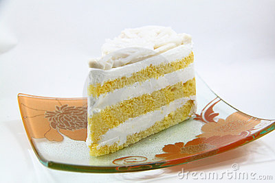 A piece of coconut cake on white background