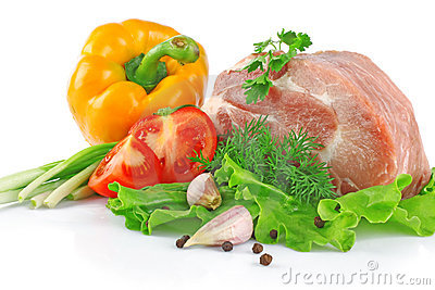Piece of fresh raw meat with vegetables