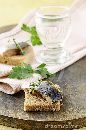 Piece of herring on rye bread