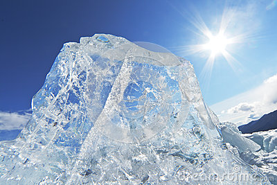 Piece of ice and the sun on winter Lake Baikal