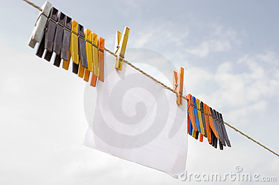 A piece of paper hanging on cord with clothespins
