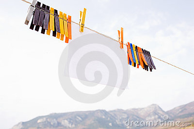 Piece of paper hanging on cord with clothespins
