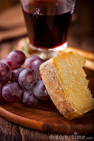 Piece of Pecorino and red Grapes
