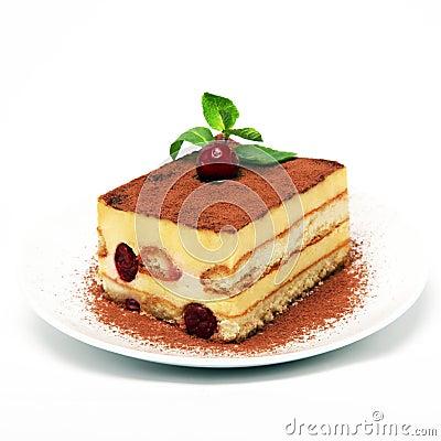 Piece of tiramisu cake on white plate