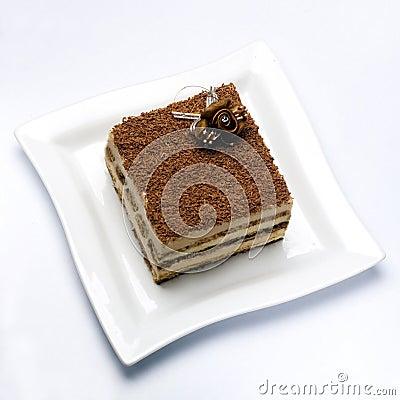 Piece of tiramisu on white plate