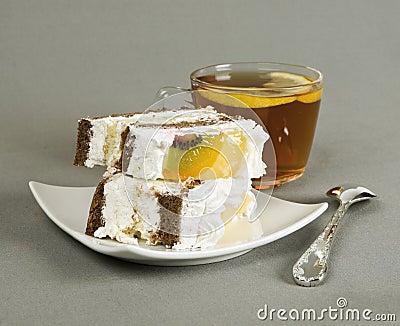 Pieces of cake, tea and tea-spoon