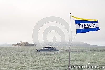 Pier 39 flag and alcatraz