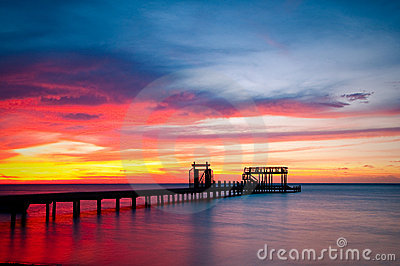 Pier and colorful ocean sunset