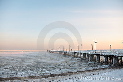 Pier, jetty on the sea-ice-floe. Poland, Gdynia
