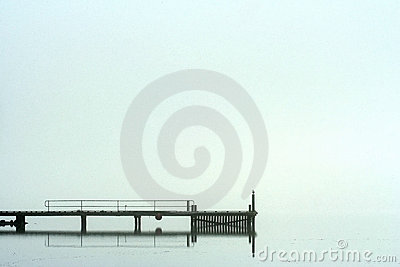 Pier in morning fog