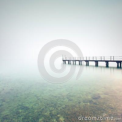 Free Pier Or Jetty Silhouette In A Foggy Lake. Garda Lake, Italy Stock Photo - 29923410