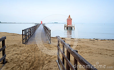 Pier with red tower.Lignano-Italy.
