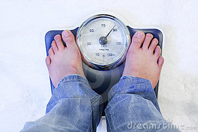Pies en escala del peso
