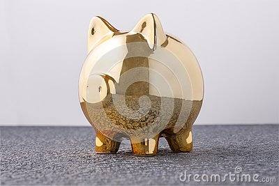 Pig money box golden on black background concept of financial insurance, protection, safe investment or banking Stock Photo