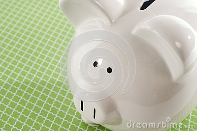 Piggy Bank against Green Background