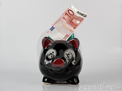 Piggy bank with bank note