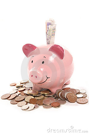Piggy bank with British currency money