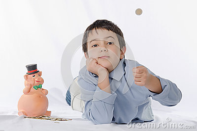 Piggy bank and child
