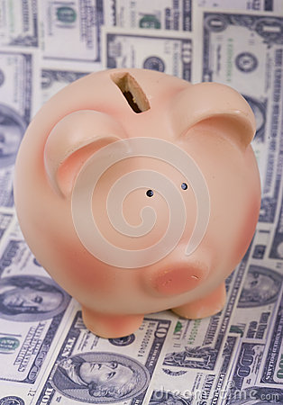 Piggy bank and dollar bills