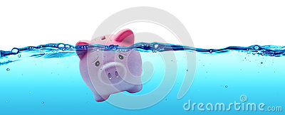 Piggy bank drowning in debt Stock Photo