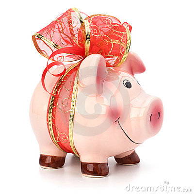 Piggy bank with festive bow isolated