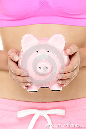 Piggy bank in front of stomach