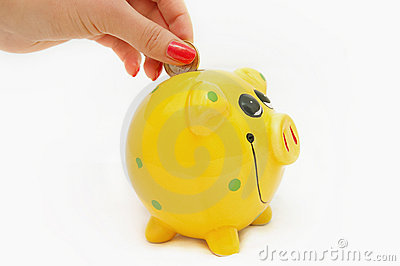 Piggy bank and hand with coin isolated on white ba