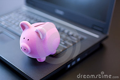 Piggy bank on laptop