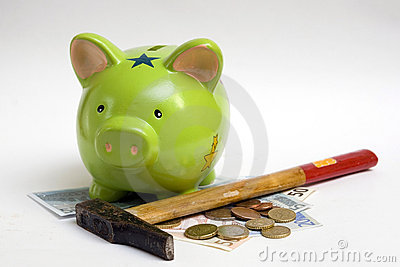 Piggy bank, money and hammer