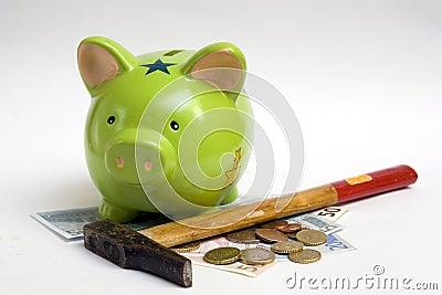 Piggy bank, money and hammer