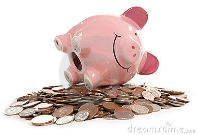 Piggy bank moneybox with British currency coins