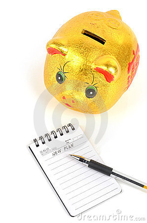 Piggy bank and notepad