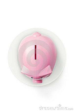 Piggy bank on plate