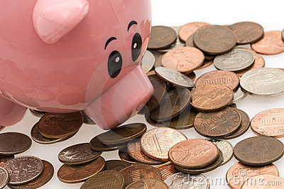 Piggy bank and scattered money