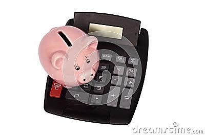 Piggy Bank Sitting On Top Of Calculator