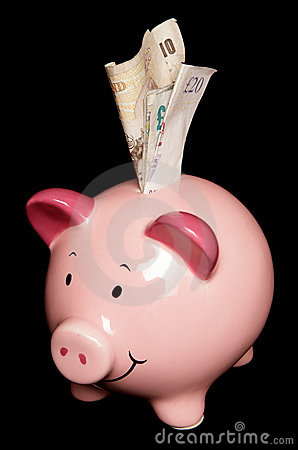 Piggy bank with sterling money notes