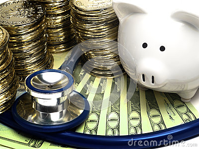 Piggy Bank With Stethoscope, Gold Coins And Money