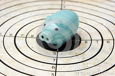 Piggy bank on target concept