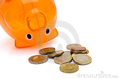 Piggy bank upside down with coins