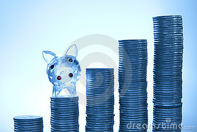 Piggy with coins on blue background