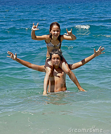 Piggyback (brother and sister) on sea