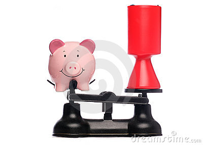 Piggybank and charity collection on scales