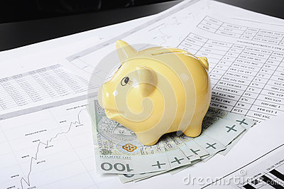 Piggybank set on the money