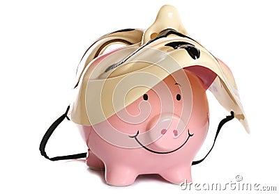 Piggybank and vendetta mask