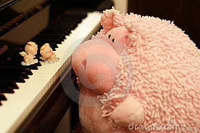 Pigs dancing on piano