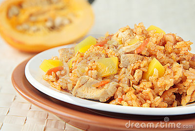 Pilaf with chunks of chicken, carrots and pumpkin